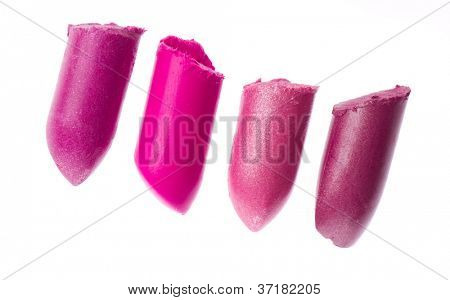 Multicoloured scraps of lipstick isolated on white background