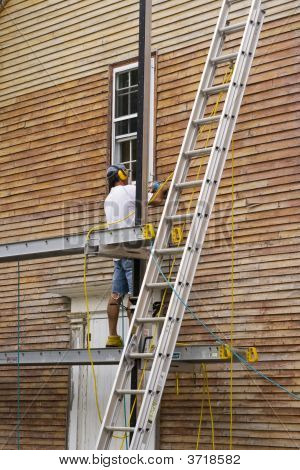 Wood Sanding The House