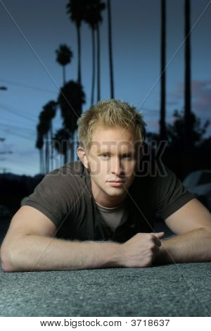 Blond Guy Laying On Ground