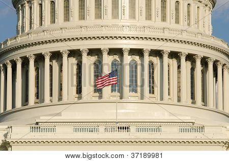 United States Capitol Building dome detail with waving US flag