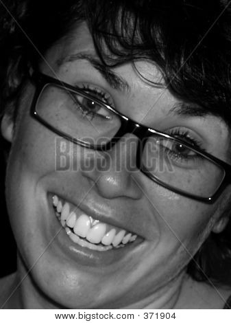 Girl With Big Smile Wearing Glasses