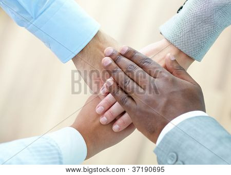Above angle of pile of hands of business partners