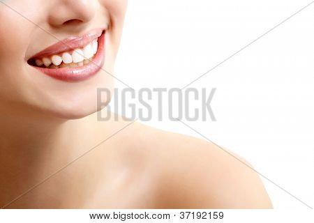 Beautiful wide smile of young fresh woman with great healthy white teeth. Isolated over white background