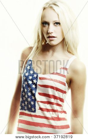 Retro styled fashion image of blonde woman wearing American Flag t-shirt