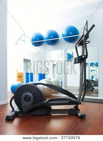 Aerobics cardio training elliptic crosstrainer bicycle device at gym