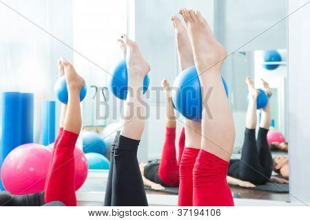 Aerobics pilates women feet  with yoga balls in a row on fitness class