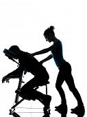 one man and woman perfoming chair back massage in silhouette studio on white background