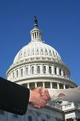picture of capitol building  - handshake between business people and US Capitol building - JPG