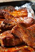 Delicious Spicy Barbeque Ribs In Roasting Tray On Foil poster