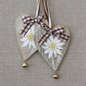 picture of edelweiss  - Two hearts with edelweiss on grey fabric background - JPG