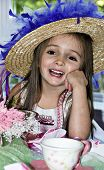 image of tea party  - Little girl dressed up for a tea party with a fancy hat and pink beads - JPG