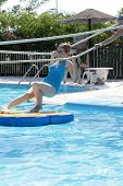 stock photo of tarzan  - Teen is in tarzan pool Water Park Rhodes - JPG
