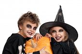 picture of warlock  - Boy and girl wearing halloween costume with pumpkin on white background - JPG