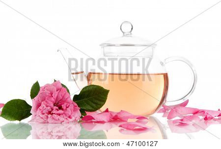 Kettle of tea from tea rose isolated on white