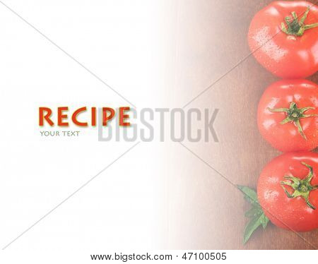 Fresh tomatoes on wooden table with copy space