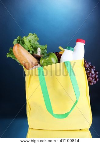 Eco bag with shopping on dark blue background