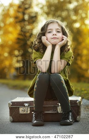 resentful girl on suitcase