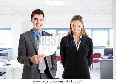 Portrait of two business people in their office