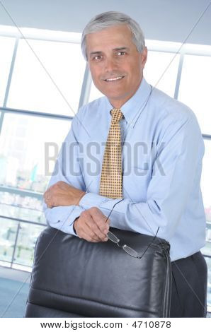 Businessman Leaning Of His Chair