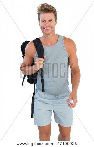 Man in sportswear holding rucksack on white background