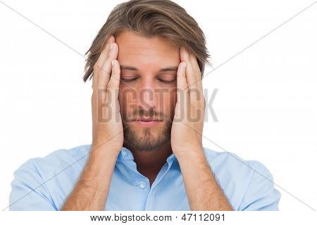Man touching his temples to calm a headache on white background