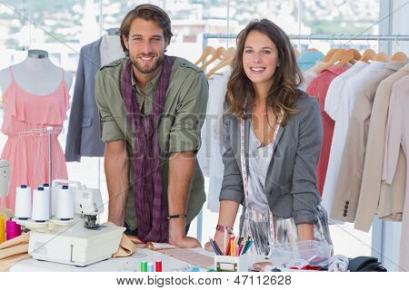 Attractive fashion designers at work