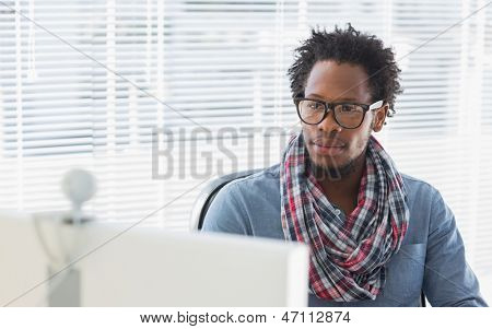 Creative business employee having a videocall in a modern office