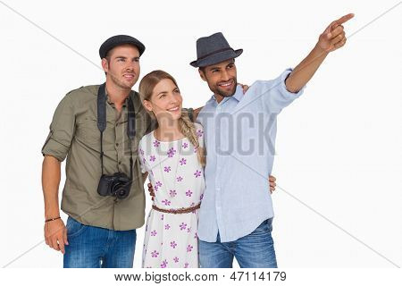 Man pointing to something with friends and one has camera on white background