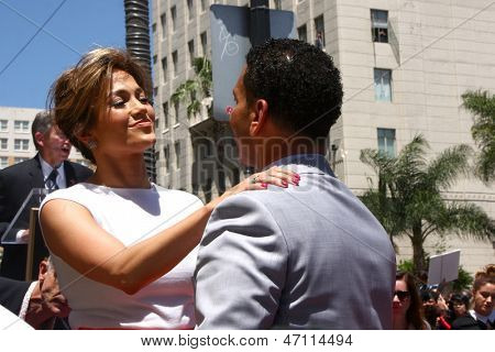 LOS ANGELES - JUN 20:  Jennifer Lopez, Benny Medina at the Hollywood Walk of Fame star ceremony for Jennifer Lopez at the W Hollywood Hotel on June 20, 2013 in Los Angeles, CA