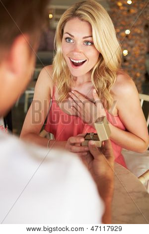 Man Proposing To Woman In Restaurant