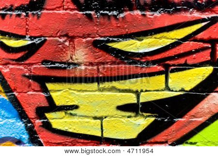 Graffiti: Abstract face on The Textured Brick Wall