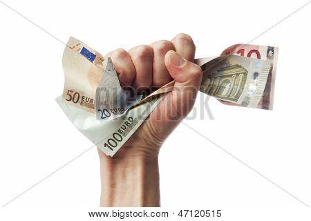Fist holding european currency bills