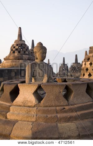 Early Morning At The Borobudur With Buddha