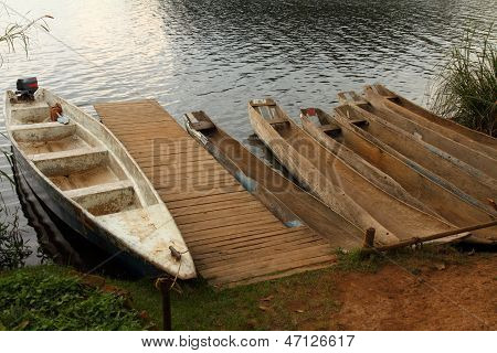 Dugout Canoes Waiting At The Dock