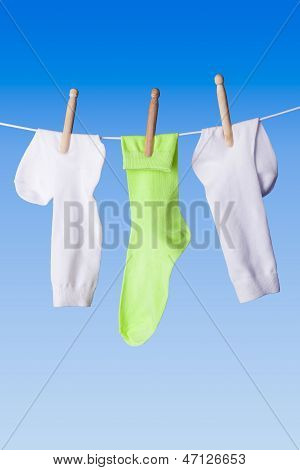 White And Green Socks On Washing Line