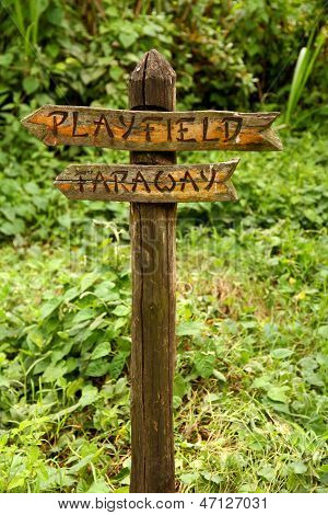 Wooden Sign To Playfield And Faraway