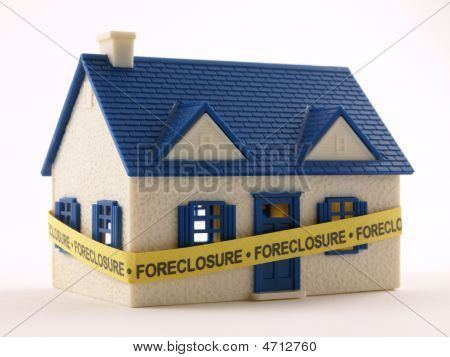 House With Foreclosure Tape
