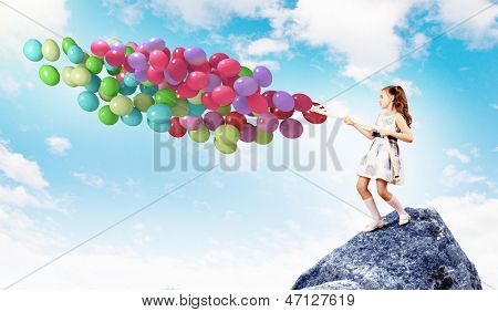 Image of little cute girl with bunch of color balloons