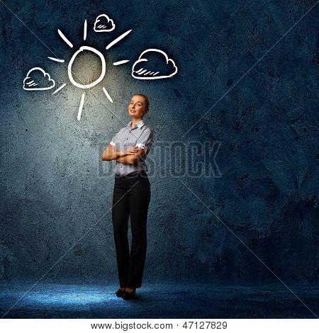 Image of attractive businesswoman against dark background