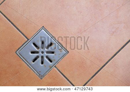 Sewer Grate Drain Water On Floor In Bathroom