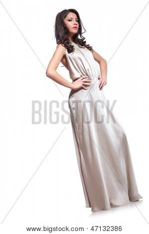 full length photo of a young beauty woman looking at the camera while holding her hands on her hips. isolated on white background