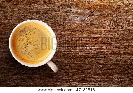 cup of fresh espresso on table, view from above