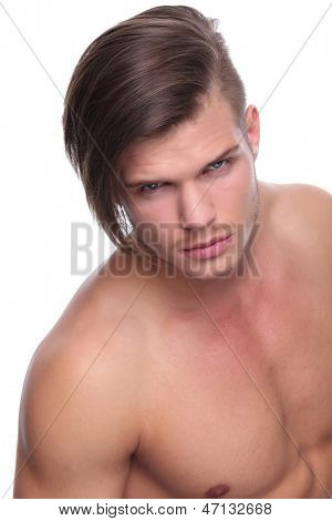 closeup of a young fashion man standing naked and looking at the camera. isolated on white background