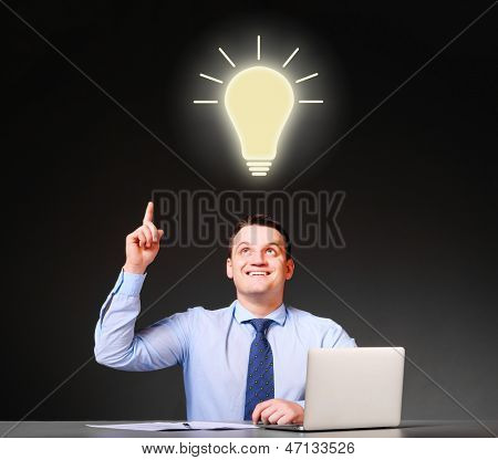 idea concept. businessman is sitting at his table with laptop