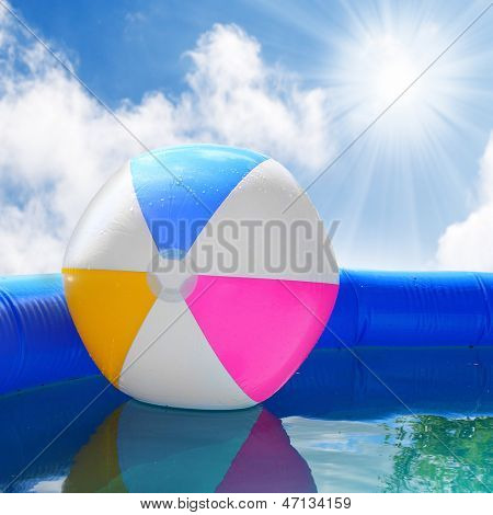 Inflatable pool with floating plastic ball.