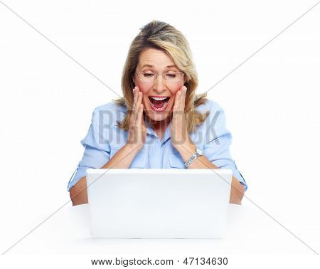 Happy senior woman with laptop computer. Isolated over white background.