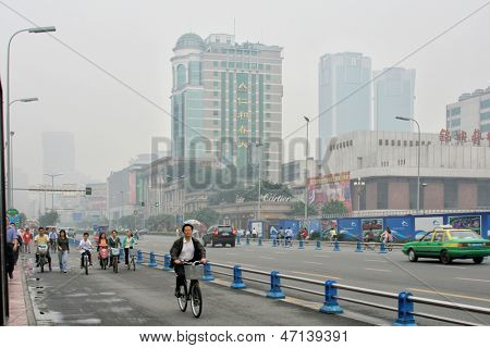 CHENGDU, CHINA - SEPTEMBER 16: Special line for bicyles, pedicabs on the multilane road on September 16, 2006 in Chengdu, Sichuan, China