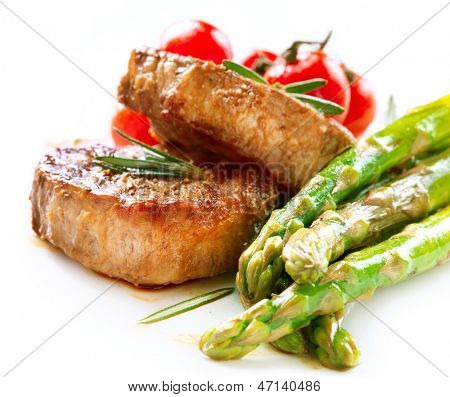 Grilled Beef Steak Meat with Asparagus and Cherry Tomato. Steak Dinner. Food. BBQ Grill. Berbeque