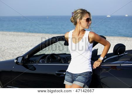 woman near car sea on background