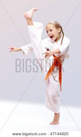 Techniques of self-defense karate girl beats a kick